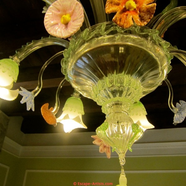 These exquisite chandeliers are even in the bathroom!